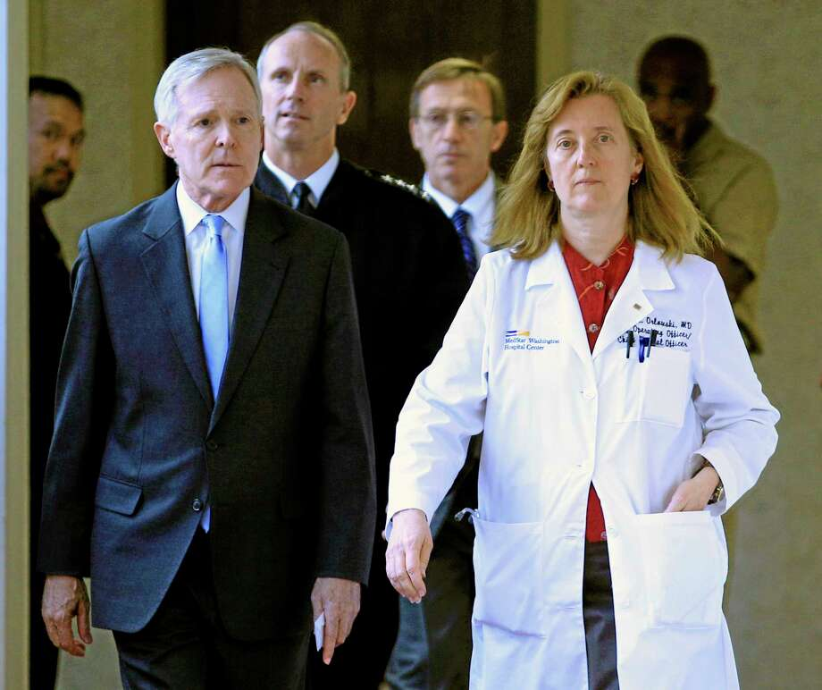Secretary of the Navy Ray Mabus and  Washington Hospital Center chief operating officer Janis M. Orlowski walk to a news conference in Washington, Monday, Sept. 16, 2013, after visiting the people injured in the shooting at Washington Navy Yard. (AP Photo/Jose Luis Magana) Photo: AP / FR159526 AP
