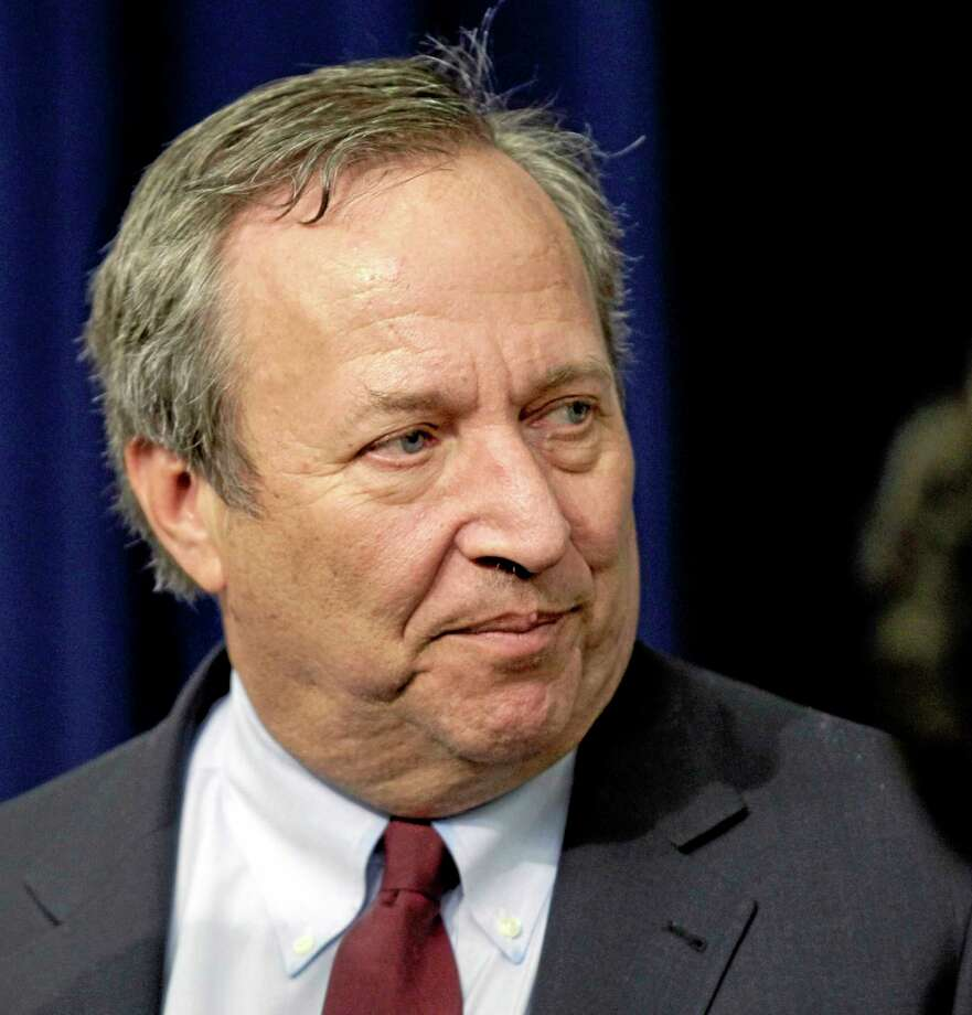 File- This Dec. 17, 2010 file photo shows Director of the National Economic Council Lawrence Summers arriving for the tax cut extension bill  during a ceremony at the Eisenhower Executive Office Building in the White House complex in Washington.  The staunch resistance that pushed Lawrence Summers to withdraw from consideration for Federal Reserve chairman came from Obama's own Democratic base, not the conservatives who kept him from nominating Susan Rice as secretary of state.  (AP Photo/J. Scott Applewhite, File) Photo: AP / AP