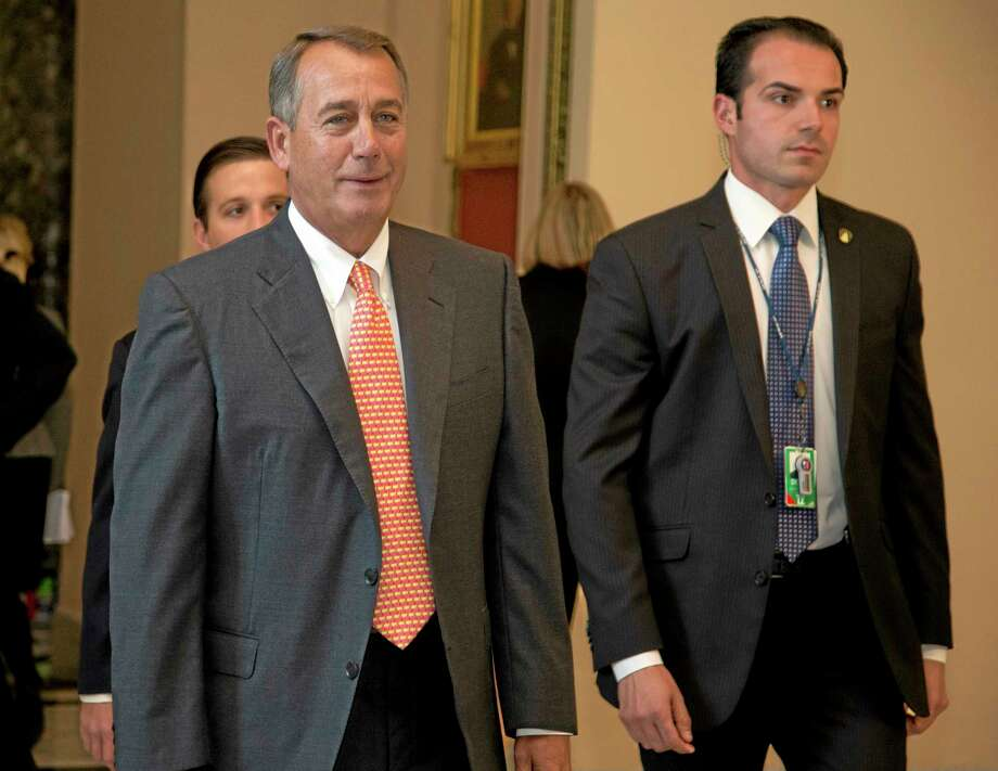House Speaker John Boehner of Ohio walks vote on the House floor on Capitol Hill, Thursday, Sept. 19, 2013 in Washington. House Republican leaders scrambled Thursday to line up support in advance of a late-afternoon vote on legislation that would cut nearly $4 billion a year from the food stamp program, now used by 1 in 7 Americans. (AP Photo/Carolyn Kaster) Photo: AP / AP