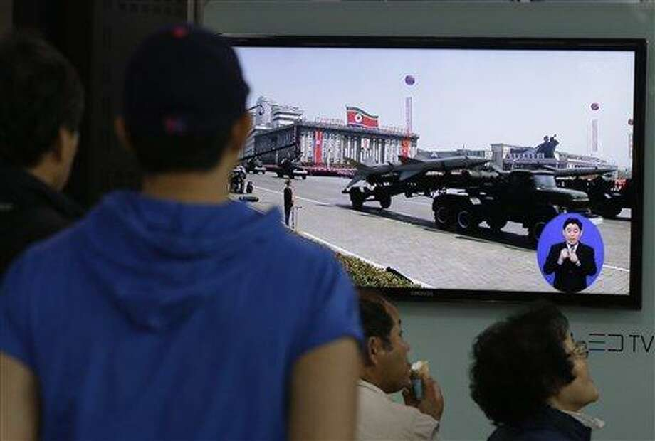 South Koreans watch TV news showing a footage of North Korean missiles on a military parade, at a Seoul Train Station in Seoul, South Korea, Saturday, May 18, 2013. North Korea fired three short-range guided missiles into its eastern waters on Saturday, a South Korean official said. It routinely tests such missiles, but the latest launches came during a period of tentative diplomacy aimed at easing tensions. (AP Photo/Ahn Young-joon) Photo: AP / AP