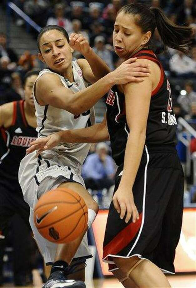 Connecticut's Bria Hartley, left, and Louisville's Shoni Schimmel, right, chase a loose ball during the second half of an NCAA college basketball game in Hartford, Conn., Tuesday, Jan. 15, 2013. (AP Photo/Jessica Hill) Photo: ASSOCIATED PRESS / A2013