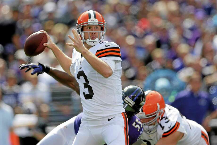 Cleveland Browns quarterback Brandon Weeden looks for an open man during Sunday's game against the Ravens in Baltimore. Third-string QB Brian Hoyer will start in Week 3 for the injured Weeden. Photo: Patrick Semansky — The Associated Press  / AP