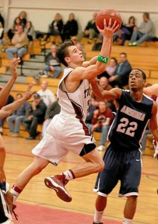 Torrington's Austin Kelson drives to the basket against Ansonia. Photo by Marianne Killackey/Special to Register Citizen / 2013