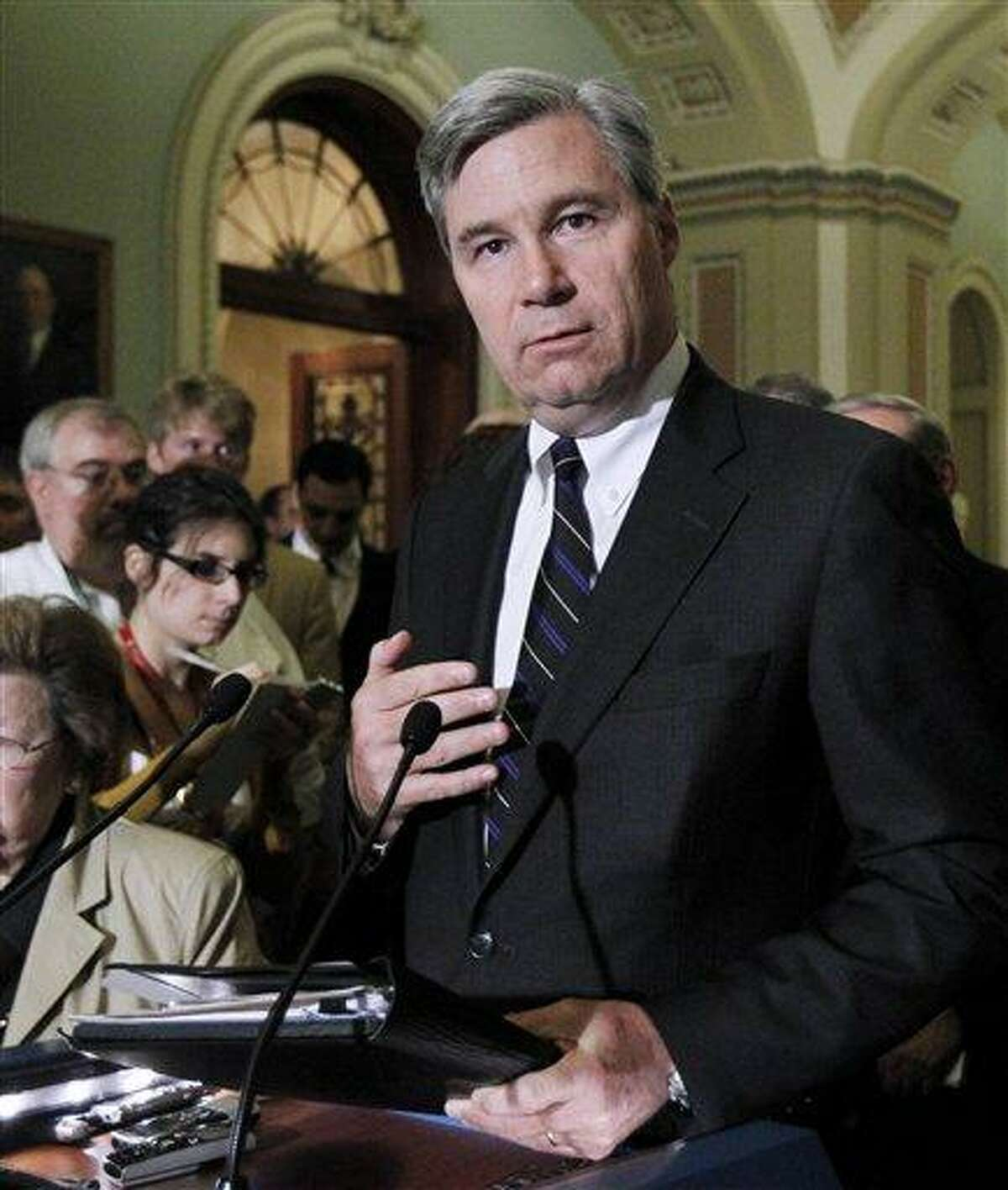 """In this photo taken June 29, 2011, photo Sen. Sheldon Whitehouse, D-R.I., speaks to reporters on Capitol Hill in Washington. Whitehouse is among a small group in the Senate pushing campaign finance reform measures that would force outside groups to disclose their donors. The Internal Revenue Service has endured withering criticism for its scrutiny of conservative political groups during the 2012 elections. """"The IRS goes AWOL when wealthy and powerful forces want to break the law in order to hide their wrongful efforts and secret political influence,"""" he says. """"Picking on the little guy is a pretty lousy thing to do."""" (AP Photo/Manuel Balce Ceneta)"""