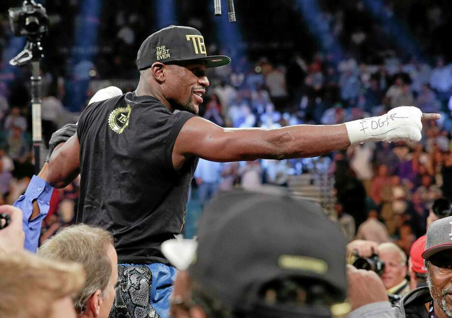 Cynthia Ross (not pictured), the judge who ruled Saturday's Floyd Mayweather Jr.-Canelo Alvarez fight a draw, is stepping away from the ring. Photo: Eric Jamison — The Associated Press  / FR156391 AP