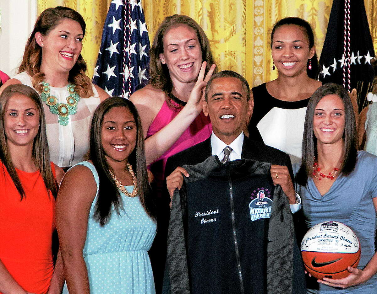 UConn women's basketball center Stefanie Dolson, top left, gives the 'bunny ears' to President Barack Obama as he poses for a photo with the team during a ceremony in the East Room of the White House in Washington on July 31 where the president honored the 2013 national champions. Also seen, from top left, are Breanna Stewart and Kiah Stokes, and from bottom left, Caroline Doty, Kaleena Mosqueda-Lewis and Kelly Faris.
