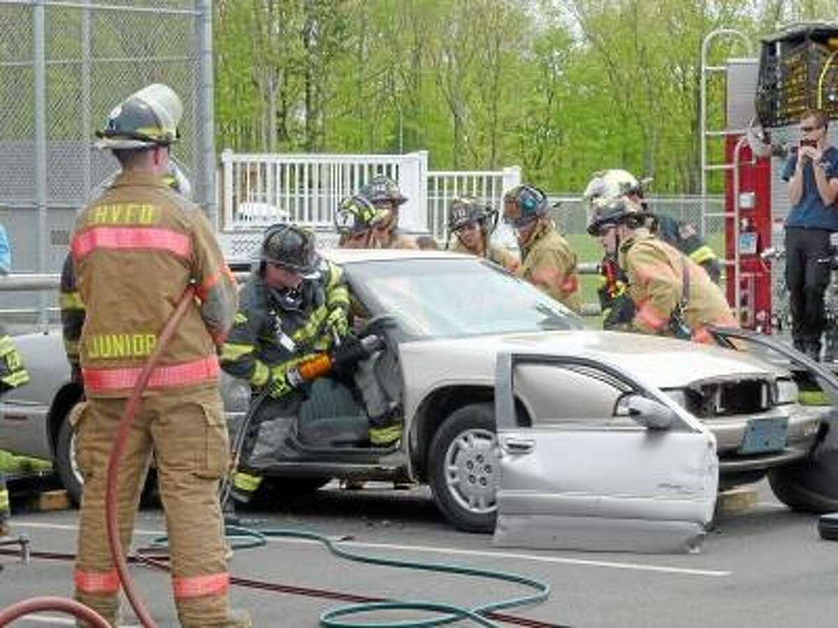 Ryan Flynn/Register Citizen - The Harwinton Fire Department showed those in attendance how they cut up a car in the case of an emergency.