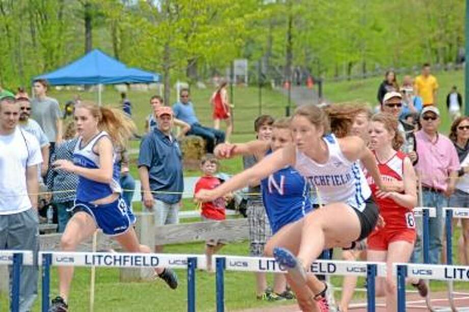 Litchfield's Emily Andrulis won the 100 meter hurdles with a time of 16.39. Photo by Pete Paguaga/Register Citizen