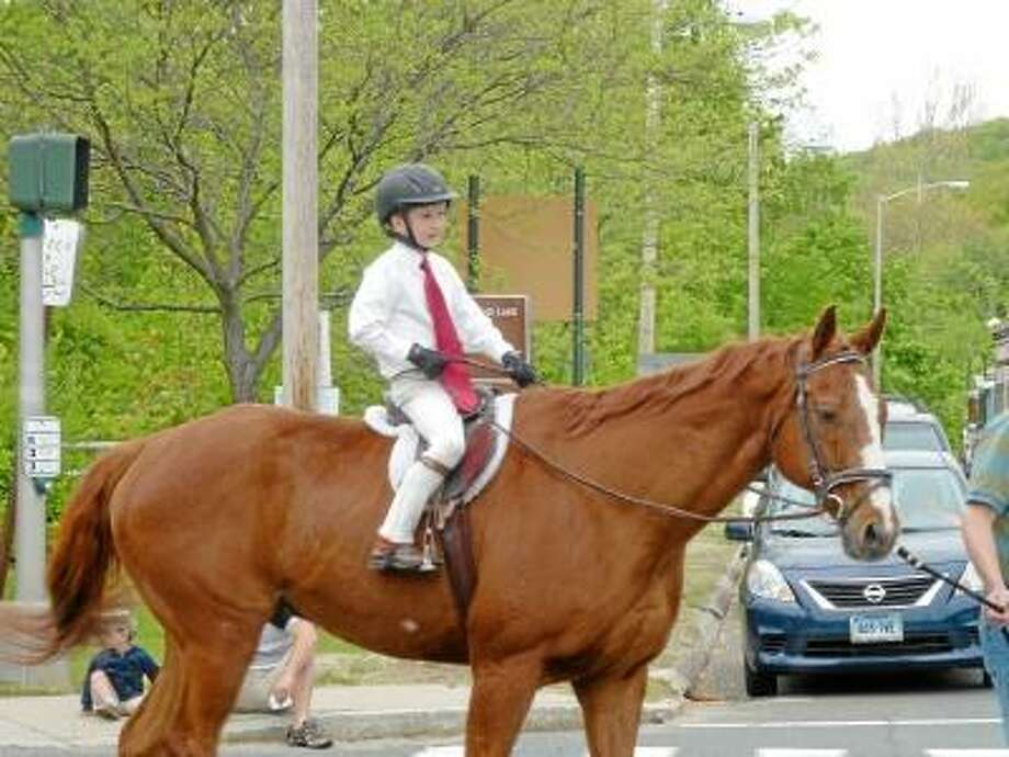 Ryan Flynn/Register Citizen - There were three parade-goers on horseback, two adults and the well-dressed rider pictured.