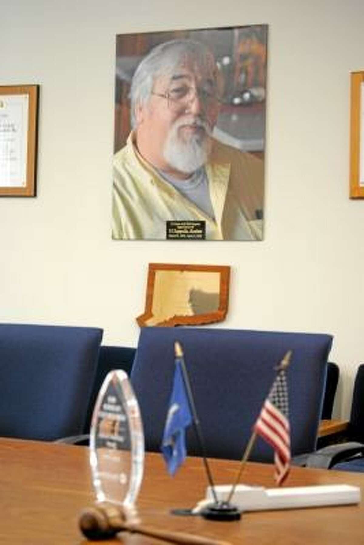 """A portrait of Thomas """"TJ"""" Zappulla hands in the Litchfield County Board of Realtors meeting room."""