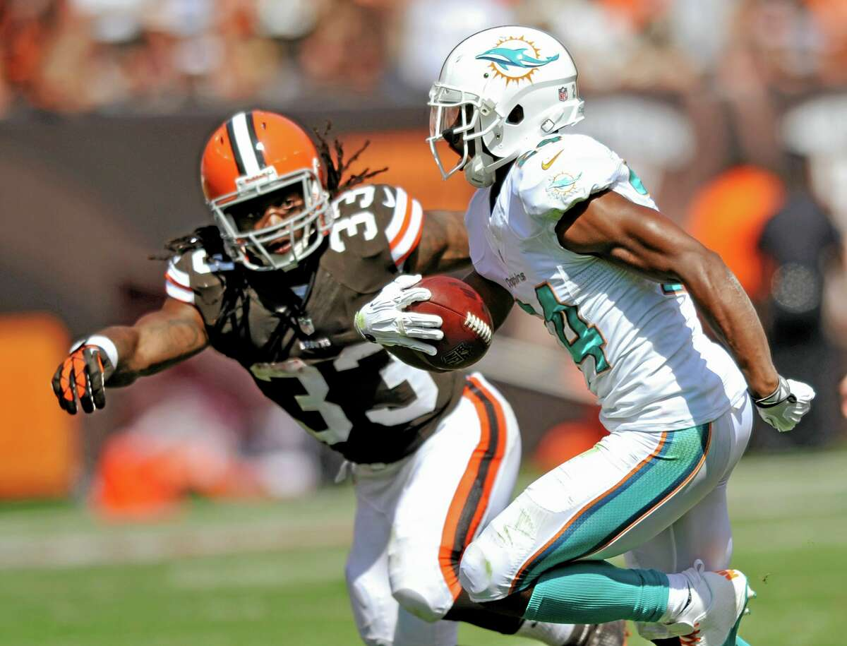 Miami Dolphins cornerback Dimitri Patterson is chased by Cleveland Browns running back Trent Richardson (33) after Patterson intercepted a pass Sept. 8 in Cleveland.