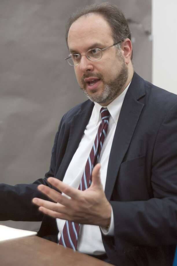 State Education Commissioner Stefan Pryor talks at an editorial bord meeting at the Register May 17, 2013.  vmWilliams