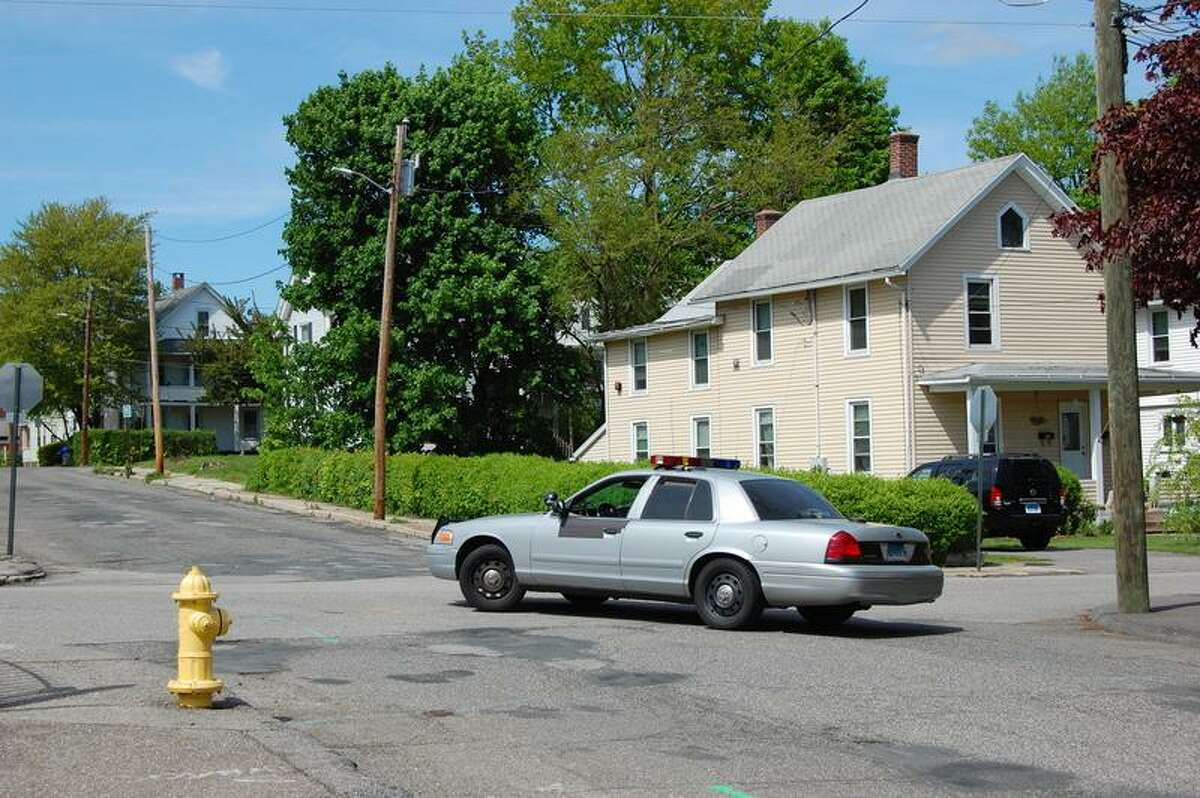 A Connecticut state trooper involved in the pursuit of a suspect in downtown Torrington. (Tom Cleary / Register Citizen)