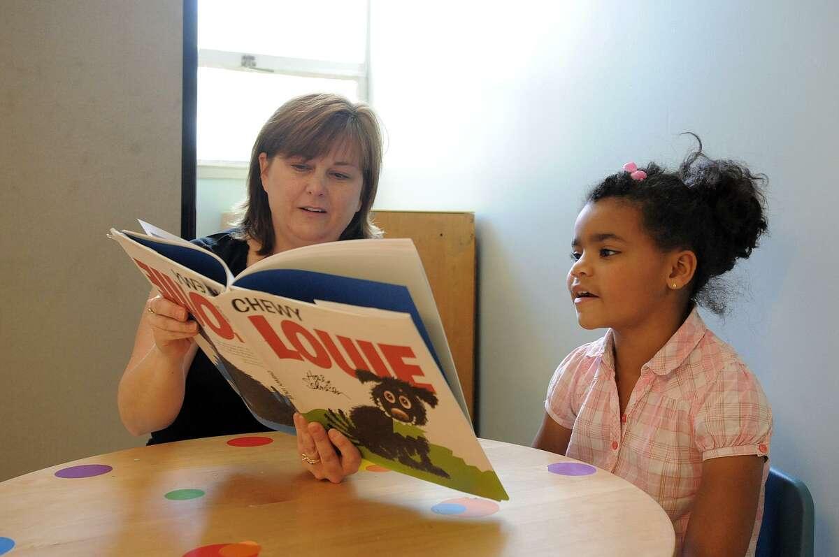 Therapist Lauren Blouin reads to Chelsea.