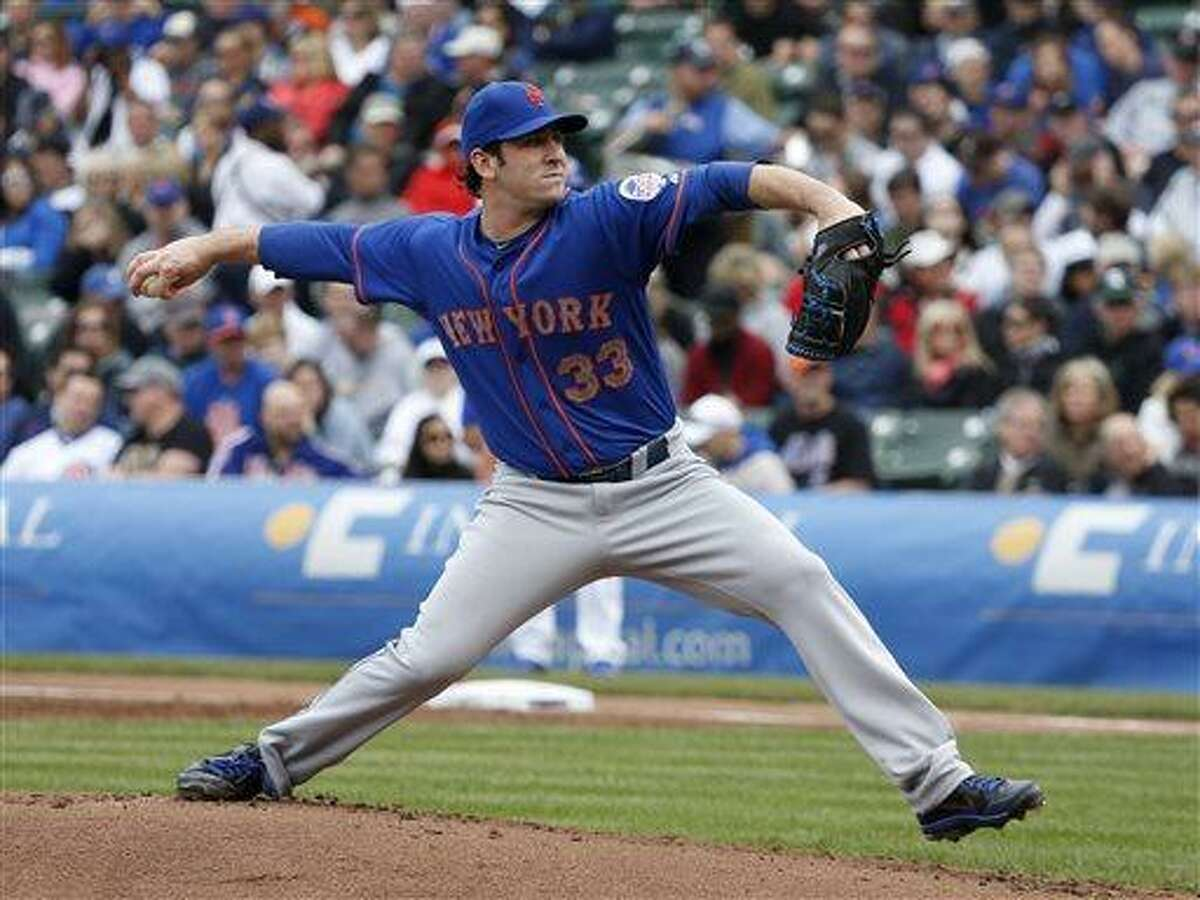 New York Mets starting pitcher Matt Harvey delivers during the first inning of a baseball game against the Chicago Cubs Friday, May 17 2013, in Chicago. (AP Photo/Charles Rex Arbogast)