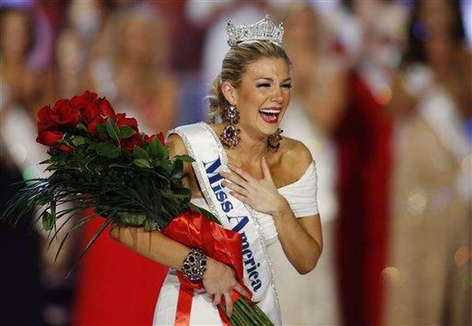 Miss New York Mallory Hytes Hagan reacts as she is crowned Miss America 2013 Saturday in Las Vegas. AP Photo/Isaac Brekken Photo: AP / FR159466 AP