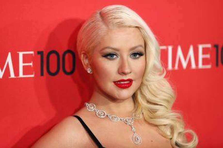Singer Christina Aguilera arrives for the Time 100 gala celebrating the magazine's naming of the 100 most influential people in the world for the past year, in New York, April 23, 2013. Photo: REUTERS / X90066