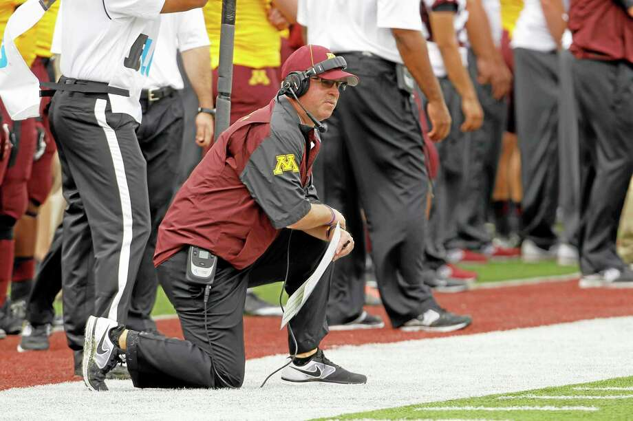 Minnesota head coach Jerry Kill kneels on the sidelines during the second quarter Saturday of the Golden Gophers' game against Western Illinois in Minneapolis. Photo: Ann Heisenfelt — The Associated Press  / FR13069 AP