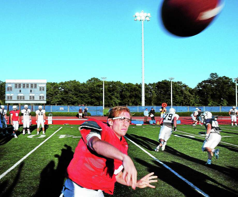 Arnold Gold — The Register Yale University quarterback Henry Furman throws a pass while wearing Google Glass during practice on Tuesday. Photo: Journal Register Co.