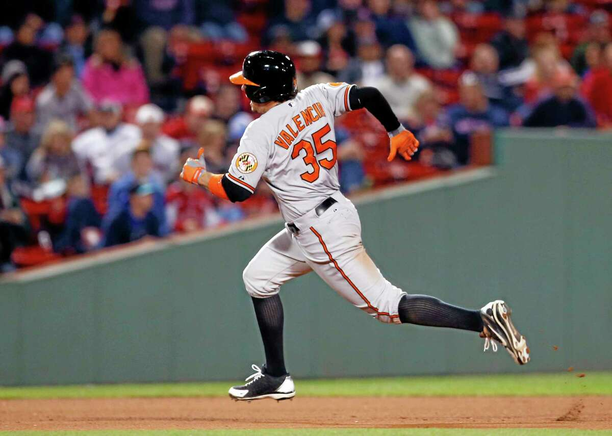 Baltimore Orioles designated hitter Danny Valencia runs to third base on a triple in the ninth inning of Tuesday's game against the Boston Red Sox.