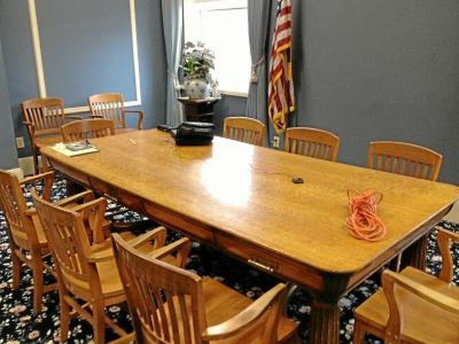 JASON SIEDZIK/ Register Citizen The Blue Room was prepared for the Board of Selectmen to consider firing town manager Dale Martin on Saturday morning, but the meeting was canceled Friday night upon the advice of town attorney Kevin Nelligan