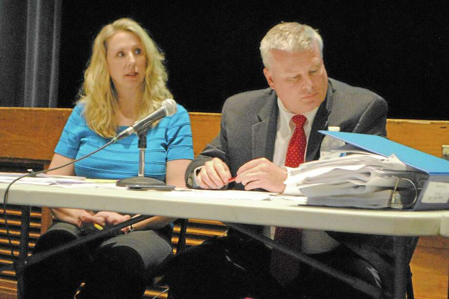 Winchester Town Finance Director Robin Manuele sits next to Town Manager Dale Martin, listening to audience comments on the $33.6 million budget. Photo: Mercy Quaye—Register Citizen