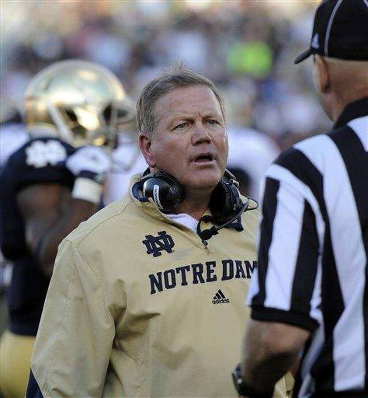 Notre Dame football coach Brian Kelly talks with a referee during the Purdue game Sept. 8, 2012 in South Bend, Ind. (AP Photo/Joe Raymond)