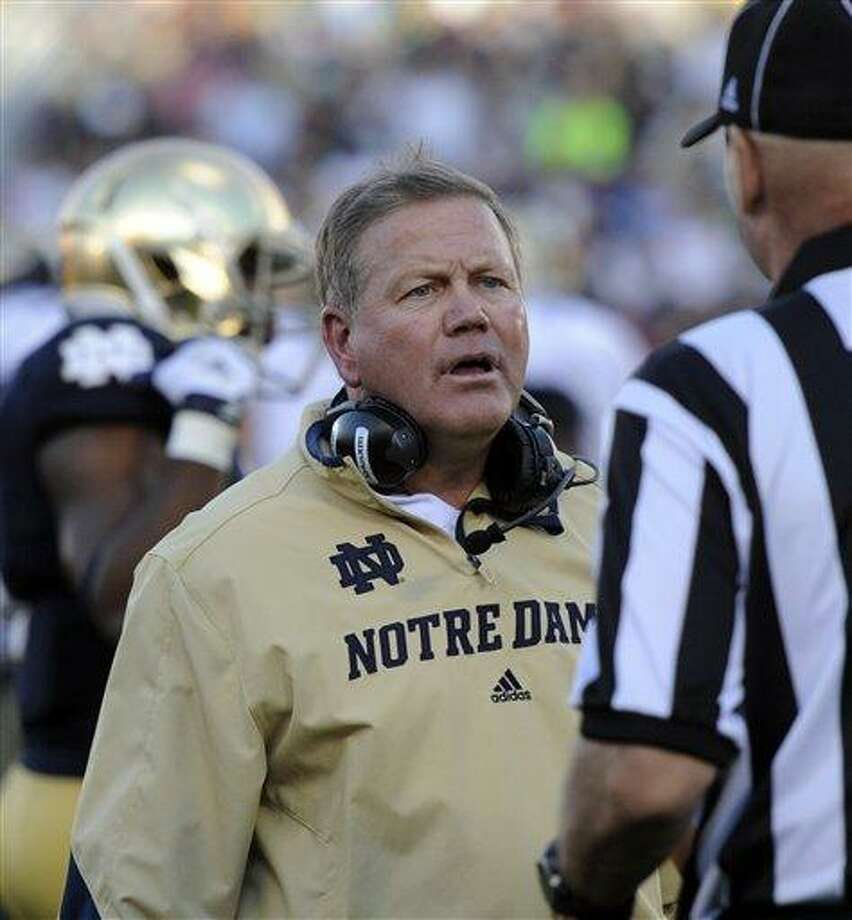 Notre Dame football coach Brian Kelly talks with a referee during the Purdue game Sept. 8, 2012 in South Bend, Ind.  (AP Photo/Joe Raymond) Photo: ASSOCIATED PRESS / Joe R. Raymond2013