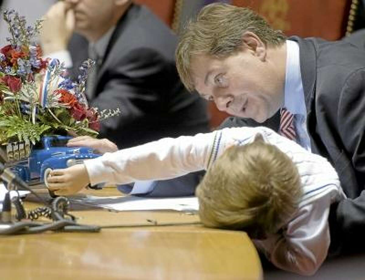 AP Photo/Jessica Hill State Sen Andrew Roraback R-Goshen and his son Andrew Kevin look at a truck full of flowers at his desk during the last day of session for the Connecticut General Assembly at the Capitol in Hartford, Wednesday, May 9, 2012. Roraback seeking the Republican nomination for the 5th Congressional District.