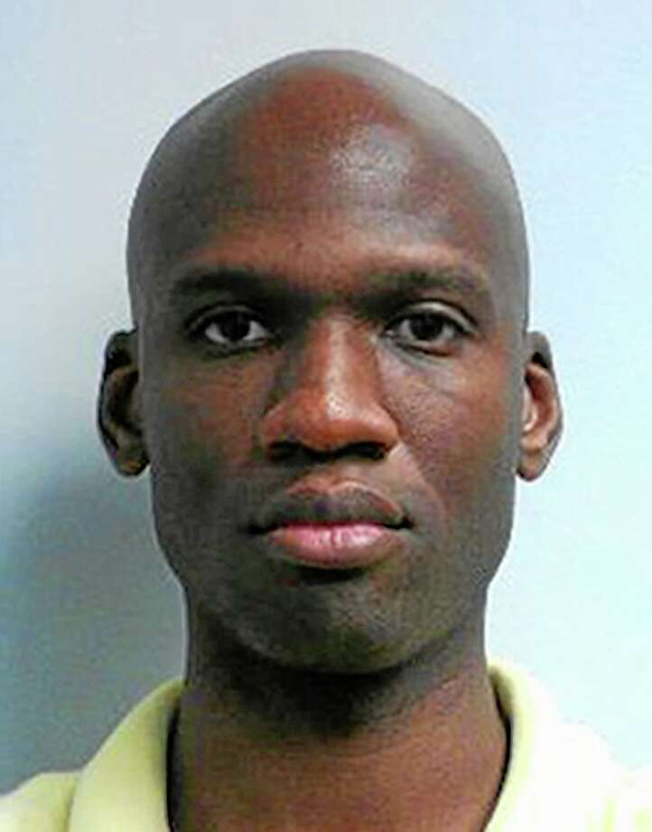 This image released by the FBI shows a photo of Aaron Alexis, who police believe was a gunman at the Washington Navy Yard shooting in Washington, Monday morning, Sept. 16, 2013, and who was killed after he fired on a police officer. At least one gunman launched an attack inside the Washington Navy Yard, spraying gunfire on office workers in the cafeteria and in the hallways at the heavily secured military installation in the heart of the nation's capital, authorities said. (AP Photo/FBI) Photo: Ap / FBI