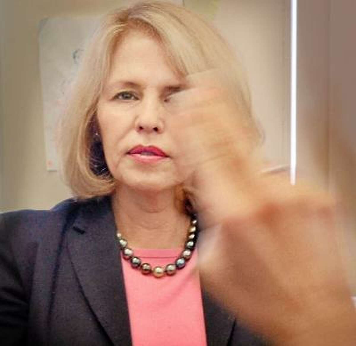 Melanie Stengel/Register Carol Miller, helps demonstrate Eye Movement Desensitization.