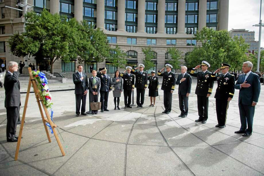 This photo provided by the Navy Media Content Service shows Secretary of Defense, Chuck Hagel, right, Gen. Martin E. Dempsey, Chairman of the Joint Chiefs of Staff, Adm. Jonathan Greenert, Chief of Naval Operations, Ray Mabus, Secretary of the Navy, and Adm. James A. Winnefeld Jr., Vice Chairman of the Joint Chiefs of Staff, render honors on Tuesday, Sept. 17, 2013, during a wreath laying ceremony at the U.S. Navy Memorial. (AP Photo/ U.S. Navy Media Content Service, Arif Patani) Photo: AP / Navy Media Content Service