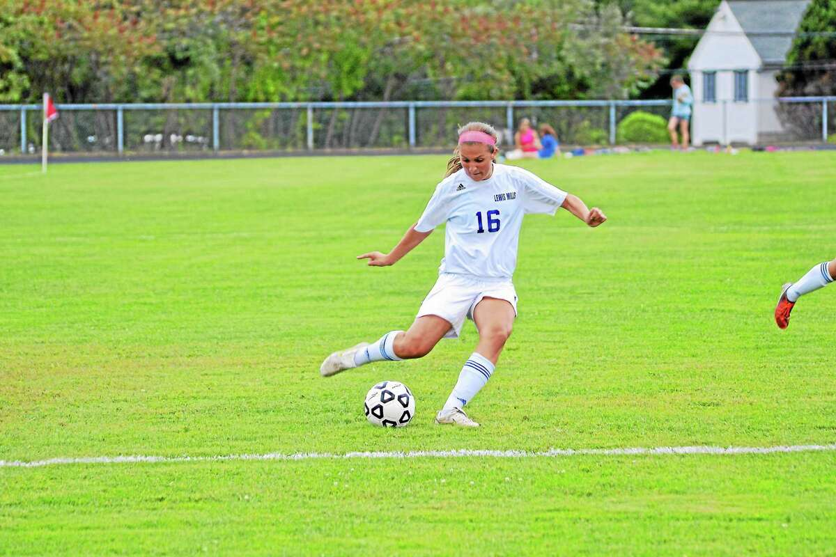 Shannon Doyle shoots and scores her second goal of the game. Doyle had three goals in Lewis Mills' 8-0 win over Wamogo.