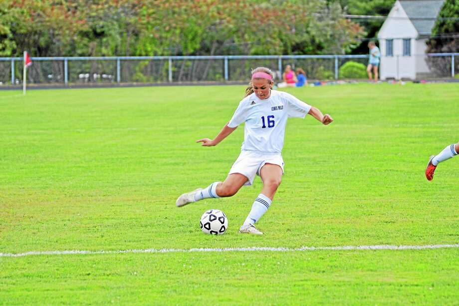 Shannon Doyle shoots and scores her second goal of the game. Doyle had three goals in Lewis Mills' 8-0 win over Wamogo. Photo: Pete Paguaga—Register Citizen