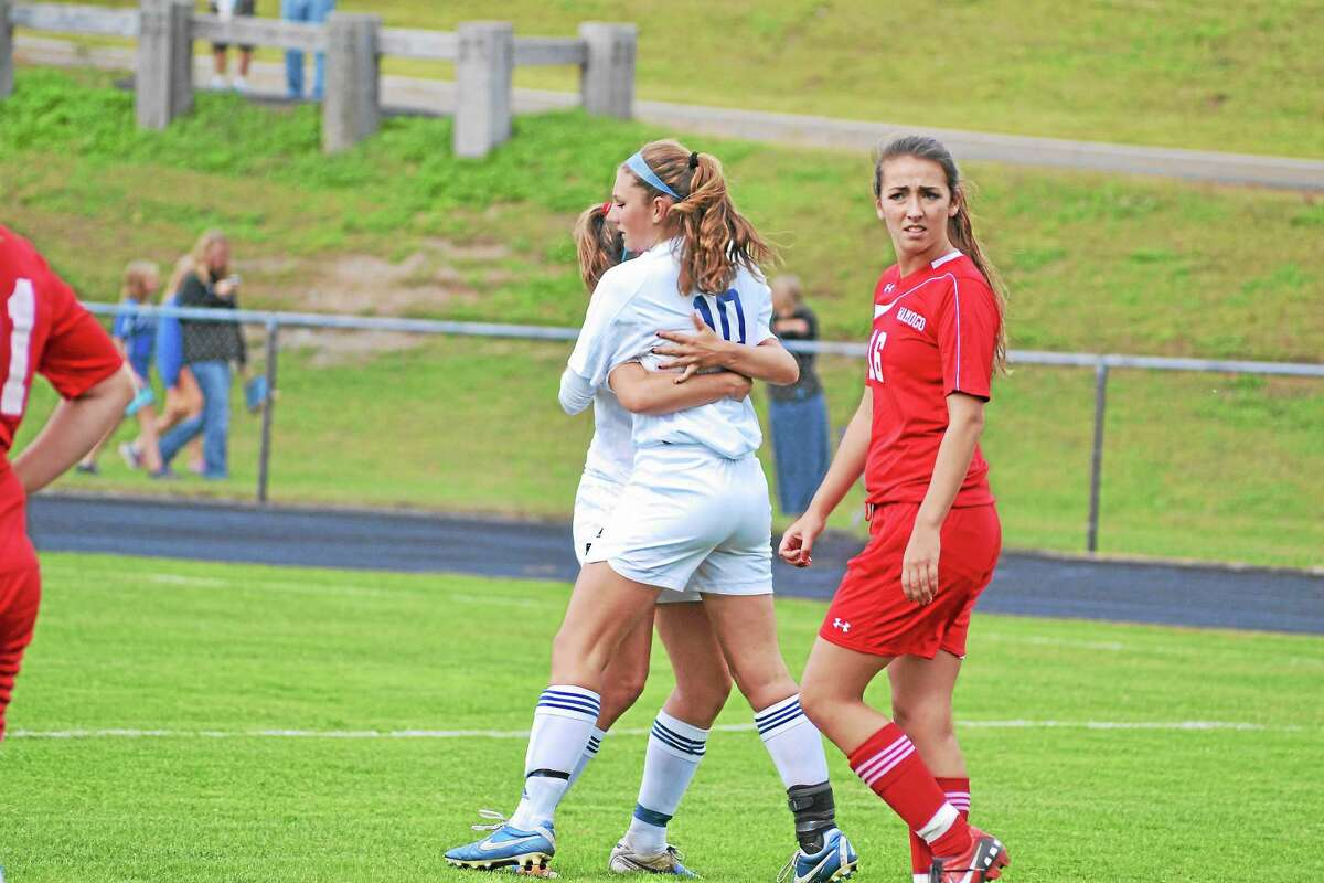 Bailey Pace hugs teammate Julia Pearson after Pearson scored the Spartans fourth goal of the game.