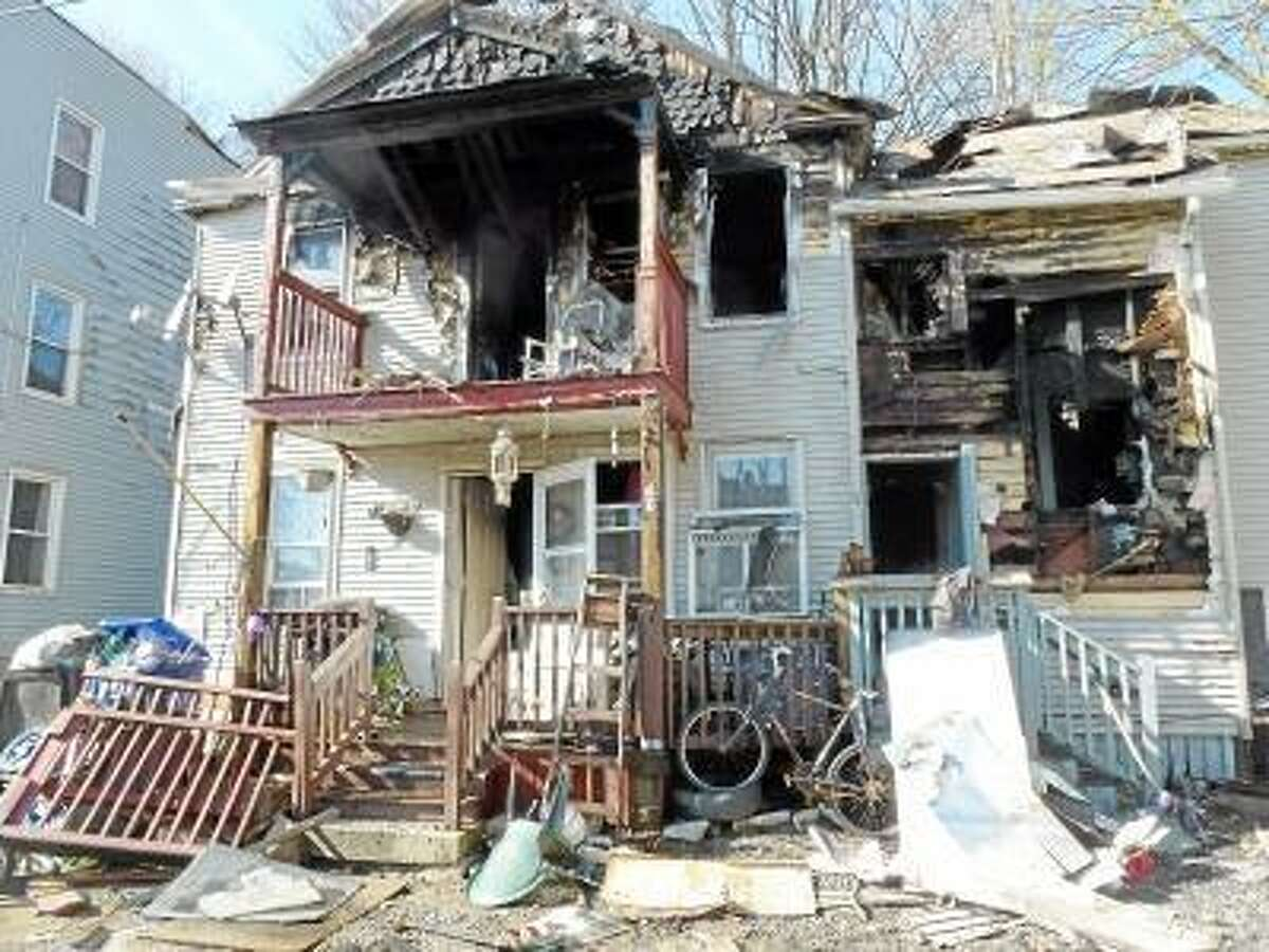 Ryan Flynn/Register Citizen -- Firefighters received minor injuries fighting the second-floor fire, but all occupants got out safely.
