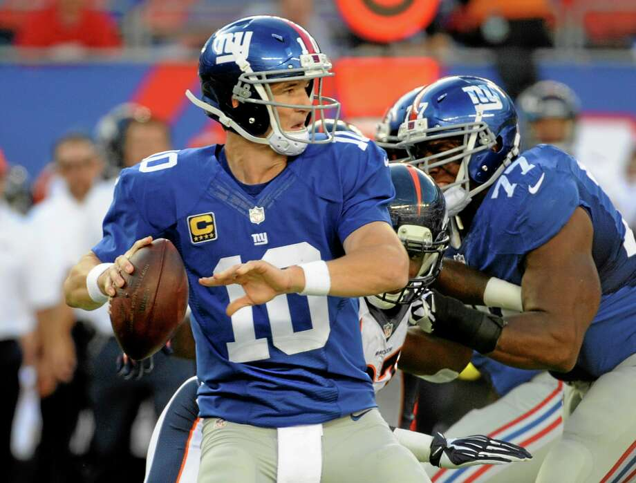 Quarterback Eli Manning and the Giants are off to an 0-2 start this season. Photo: Bill Kostroun — The Associated Press  / FR51951 AP