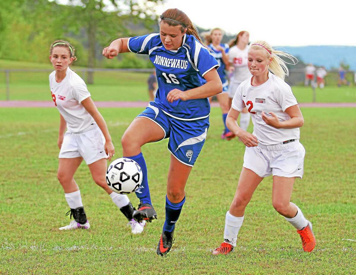 Nonnewaug's Sam DeMuro (16) dribbles the ball in her team's win over Northwestern Monday afternoon.