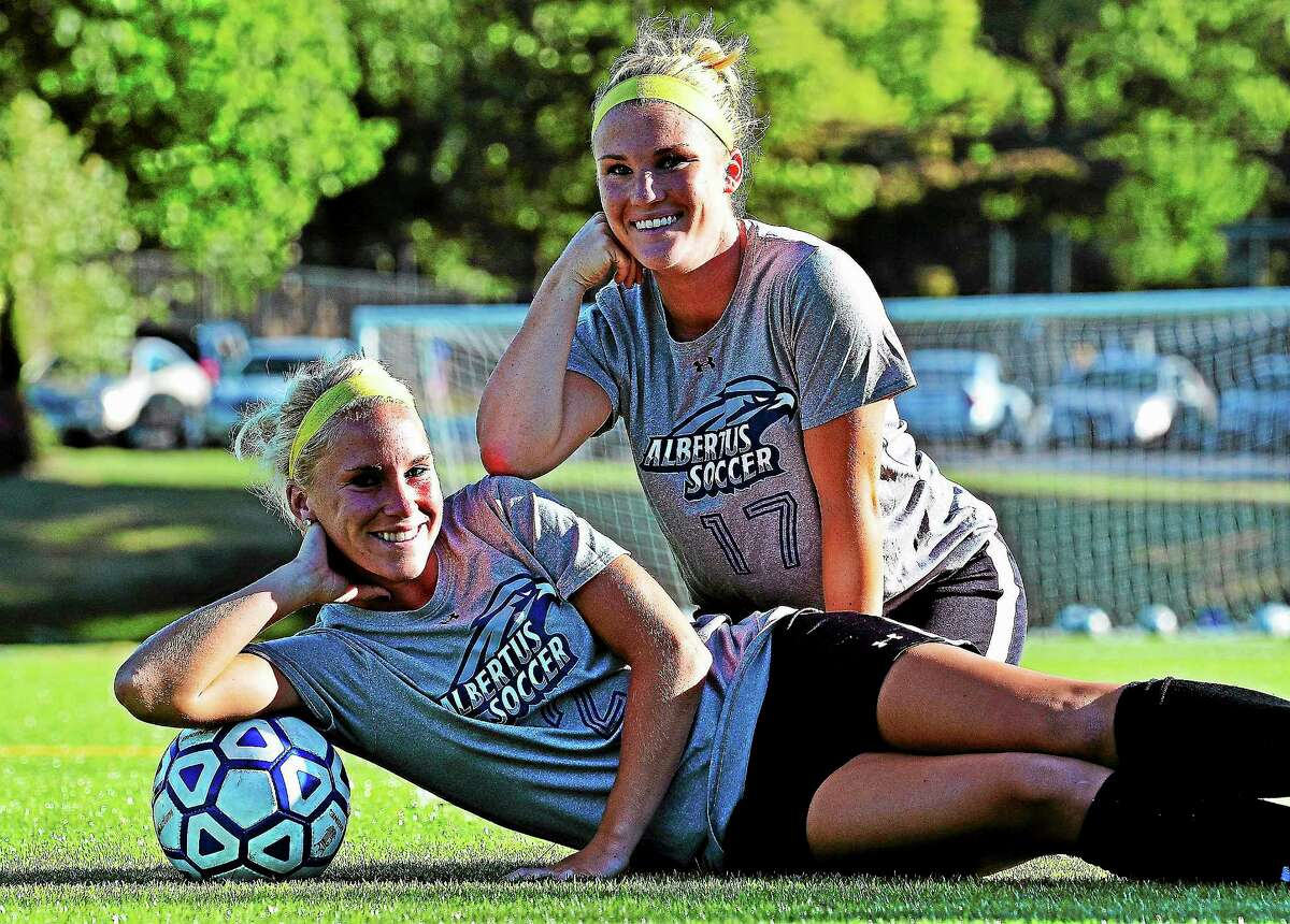 Twin sisters Shannon Skidmore, top, and Meaghan Skidmore are teammates on the Albertus Magnus women's soccer team.