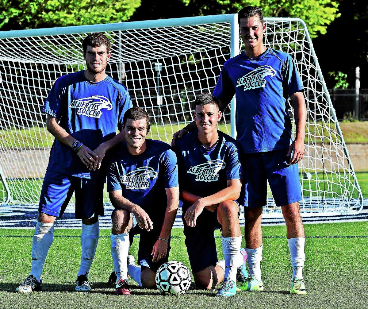 The Albertus Magnus men's soccer team has two pairs of sibling teammates — twins Riker (top left) and Richard Mitchell and brothers Erik (top right) and Austin Tomin.