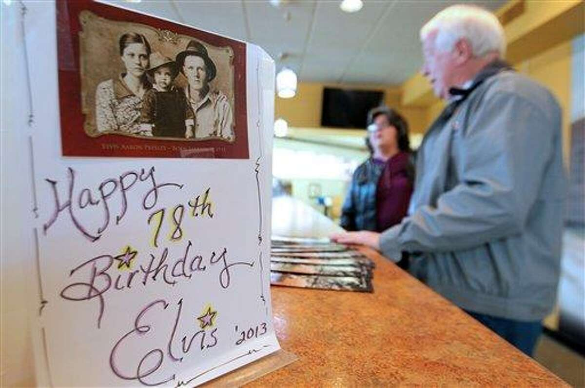Guests check in at the front desk at the Elvis Presley Birthplace Tuesday, Jan. 8, 2013, for the Elvis birthday celebrations in Tupelo, Miss. Presley was born in Tupelo, Miss., on Jan. 8, 1935, and moved to Memphis with his parents at age 13. He was 42 when he died Aug. 16, 1977. (AP Photo/Northeast Mississippi Daily Journal, Thomas Wells)