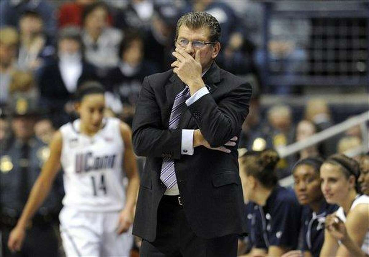 Connecticut head coach Geno Auriemma watches play during the first half of an NCAA college basketball game against Notre Dame in Storrs, Conn., Saturday, Jan. 5, 2013. (AP Photo/Jessica Hill)