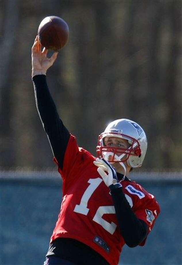New England Patriots quarterback Tom Brady throws a pass during NFL football practice at the team's facility in Foxborough, Mass., Thursday, Jan. 10, 2013. The Patriots host the Houston Texans in an AFC divisional playoff game on Sunday. (AP Photo/Stephan Savoia) Photo: ASSOCIATED PRESS / AP2013