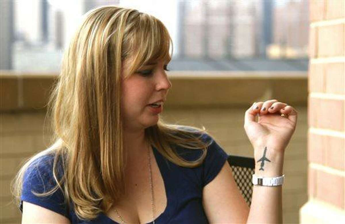 Cecelia Crocker, the lone survivor of a 1987 plane crash near Detroit Metropolitan Airport that killed 156 people, shows an airplane tattoo on her left wrist in a September 2011 photo provided by Sole Survivor Film. Crocker, then Cichan, was was 4 years old when Northwest Airlines Flight 255 crashed in Romulus, Mich. Crocker, now 30, breaks her silence in the new documentary,