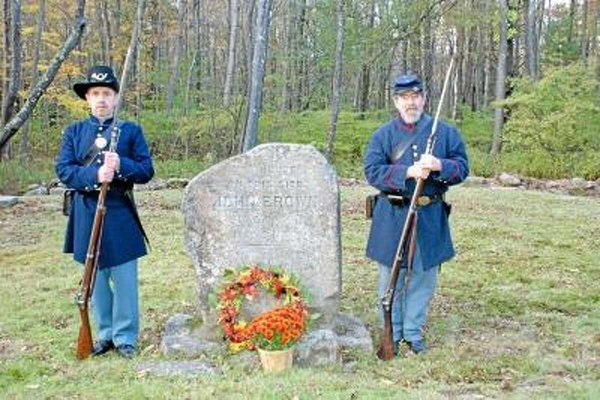 Torrington Historical Society collection Christopher Purrone, left, and Dane Deleppo, right stand at John Brown's birthplace in this file photo. It was the 150th anniversary of his raid on Harpers Ferry.