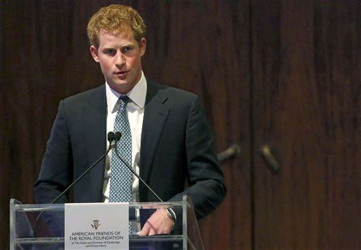 Britain's Prince Harry addresses the American Friends of The Royal Foundation dinner in New York, Tuesday, May 14, 2013. (AP Photo/Brendan McDermid, Pool)