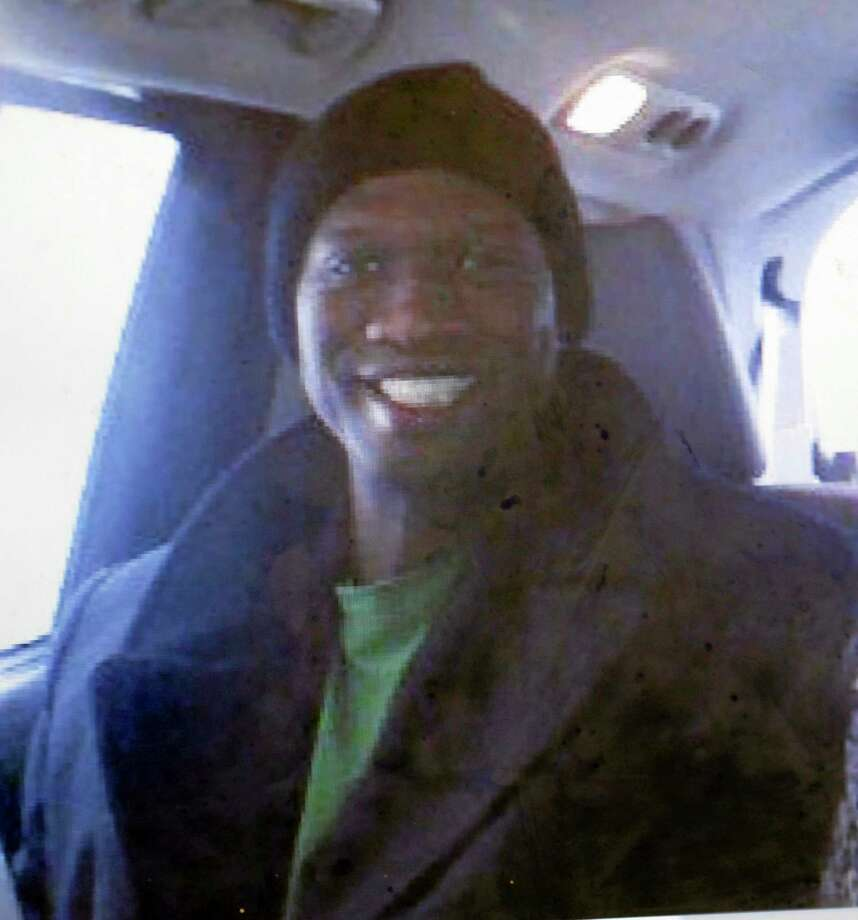 This undated cell phone photo provided by Kristi Kinard Suthamtewakul shows a smiling Aaron Alexis in Fort Worth, Texas. The FBI has identified Alexis, 34, as the gunman in the Monday shooting rampage at at the Washington Navy Yard in Washington that left thirteen dead, including himself. Photo: Kristi Kinard Suthamtewakul — The Associated Press  / Kristi Kinard Suthamtewakul