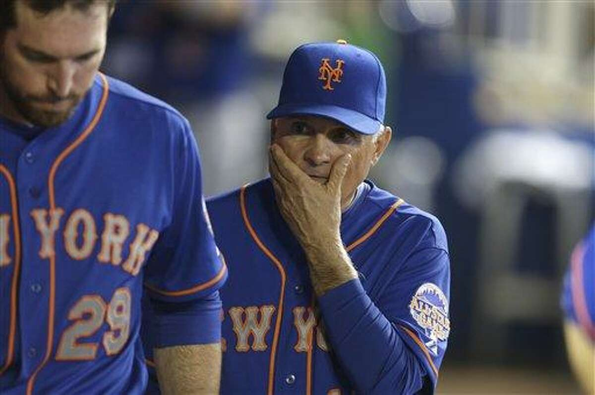 New York Mets manager Terry Collins, right, walks in the dugout during a baseball game, against the Miami Marlins Wednesday, May 1, 2013, in Miami. (AP Photo/Lynne Sladky)