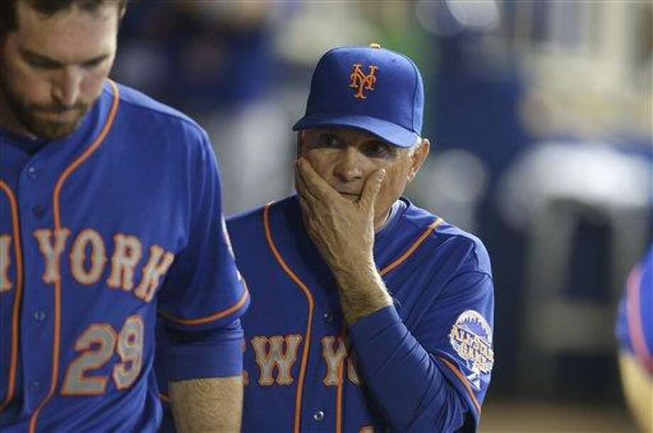 New York Mets manager Terry Collins, right, walks in the dugout during a baseball game, against the Miami Marlins Wednesday, May 1, 2013, in Miami. (AP Photo/Lynne Sladky) Photo: AP / AP