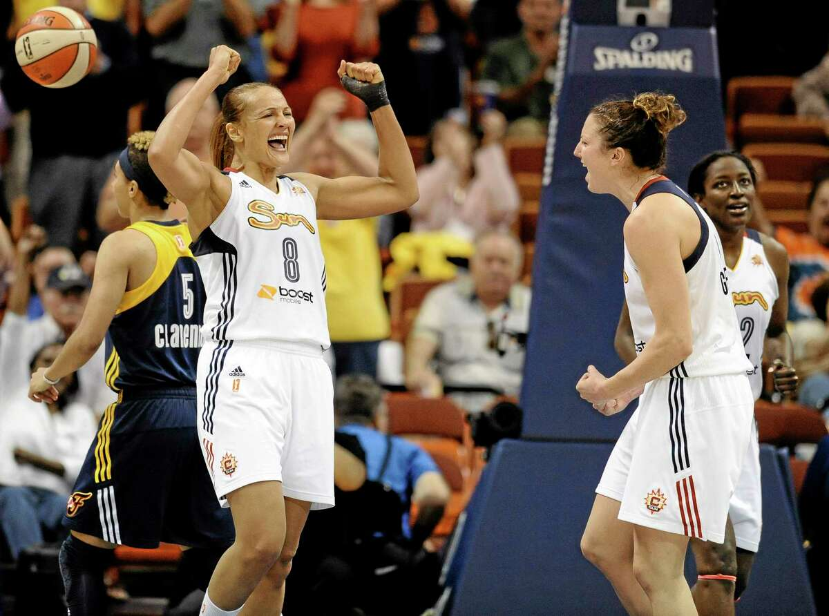 Mistie Bass, left, and Kelsey Griffin, right, celebrate after the Sun's 82-80 win against the Fever Sunday.